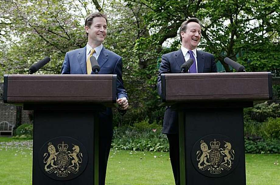 LONDON, ENGLAND - MAY 12:  Prime Minister David Cameron (R) and Deputy Prime Minister Nick Clegg share a joke as they hold their first joint press conference in the Downing Street garden on May 12, 2010 in London, England. On his first full day as Prime Minister, David Cameron has made a series of cabinet appointments including Nick Clegg as Deputy Prime Minister. The Conservatives and Liberal Democrats have now agreed to lead the country with a fully inclusive coalition government. Photo: Christopher Furlong, Getty Images
