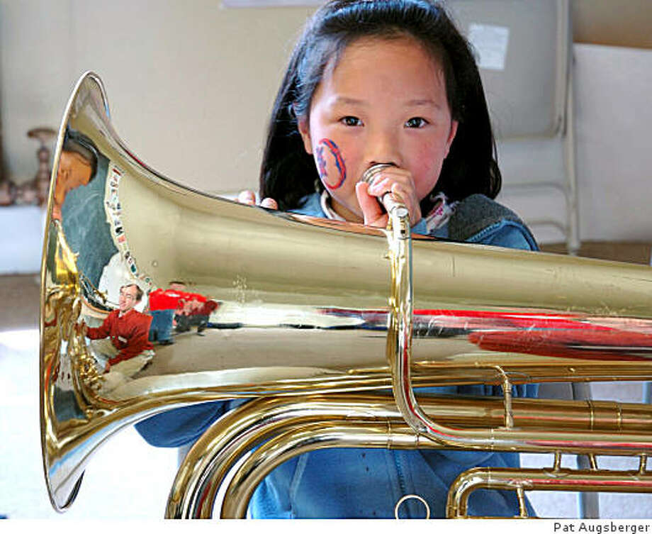 """Children explore at the """"Instrument Petting Zoo"""" at Crowden Music Center's annual Community Music Day. Oct. 26, 2008 Photo: Pat Augsberger"""