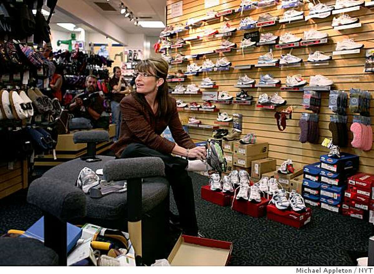 FILE -- (NYT16) CONCORD, N.H. -- Oct. 22, 2008 -- CAMPAIGN-PALIN-CLOTHES -- Gov. Sarah Palin tries on sporting shoes at a store in downtown Concord, N.H., Oct. 15, 2008. Palin ended up purchasing a pair. The Republican National Committee paid more than $150,000 for clothing, makeup and accessories in September that apparently went to Palin and her family, according to an article on Politico.com. (Michael Appleton/The New York Times)