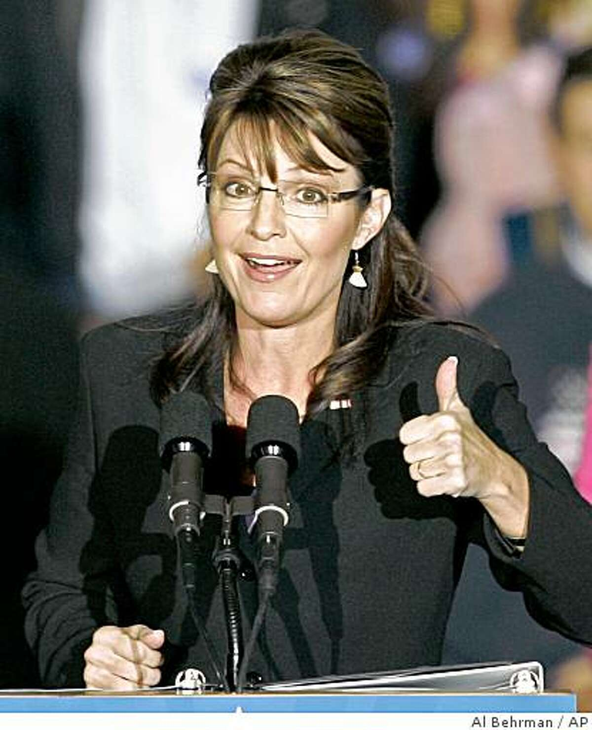 Republican vice presidential candidate Alaska Gov. Sarah Palin gives a thumbs up sign to a supporter during a rally, Wednesday, Oct. 22, 2008, at Lunken Airport in Cincinnati. (AP Photo/Al Behrman)