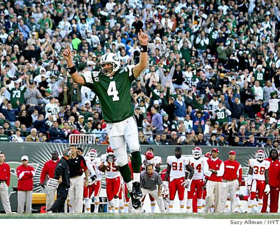 (NYT19) EAST RUTHERFORD, N.J. -- Oct. 26, 2008 -- FBN-JETS-CHIEFS -- The New York Jets quarterback Brett Favre celebrates a touchdown by Thomas Jones, as Jones followed Jets' Tony Richardson over Kansas City Chiefs'  Brandon Moore and into the end zone on third-and-an-inch, Sunday at Giants Stadium in East Rutherford, New Jersey, on Sunday, October 26, 2008. The touchdown put the Jets up 21-17 in the third quarter, during their game. The Jets won 28-24. (Suzy Allman/The New York Times) Photo: Suzy Allman, NYT