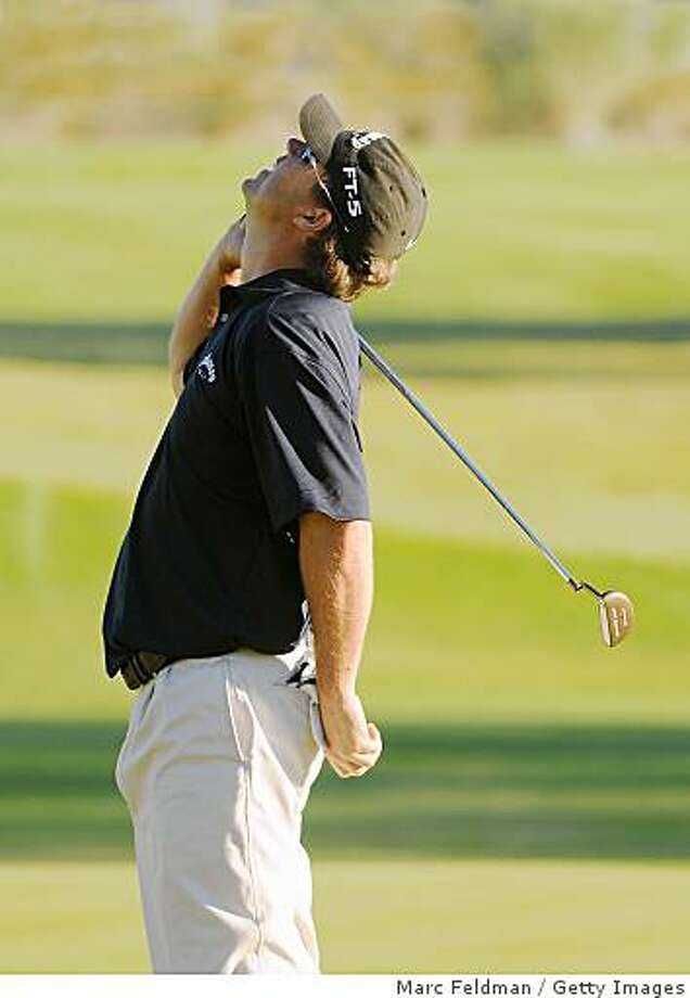 SCOTTSDALE, AZ - OCTOBER 26: Cameron Beckman celebrates his victory on the 2nd playoff hole  during the fourth and final round of  the Fry's.Com Open held at Grayhawk Golf Club on October 26, 2008 in Scottsdale, Arizona. (Photo by Marc Feldman/Getty Images) Photo: Marc Feldman, Getty Images