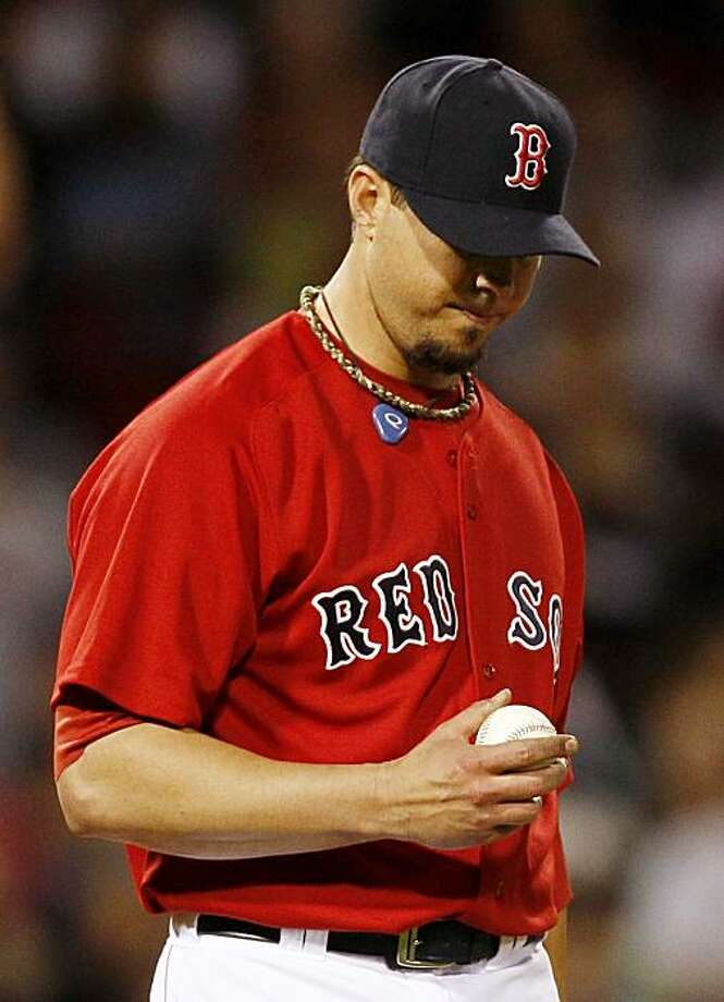 Boston Red Sox starting pitcher Josh Beckett walks back to the mound during the sixth inning of a baseball game against the New York Yankees at Fenway Park in Boston, Friday, May 7, 2010. Photo: Winslow Townson, AP