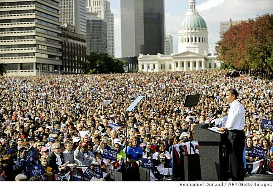 US Democratic presidential candidate Illinois Senator Barack Obama speaks in front of some 100,000 people during a rally under the Gateway Arch in St Louis, Missouri, October 18, 2008. Photo: Emmanuel Dunand, AFP/Getty Images