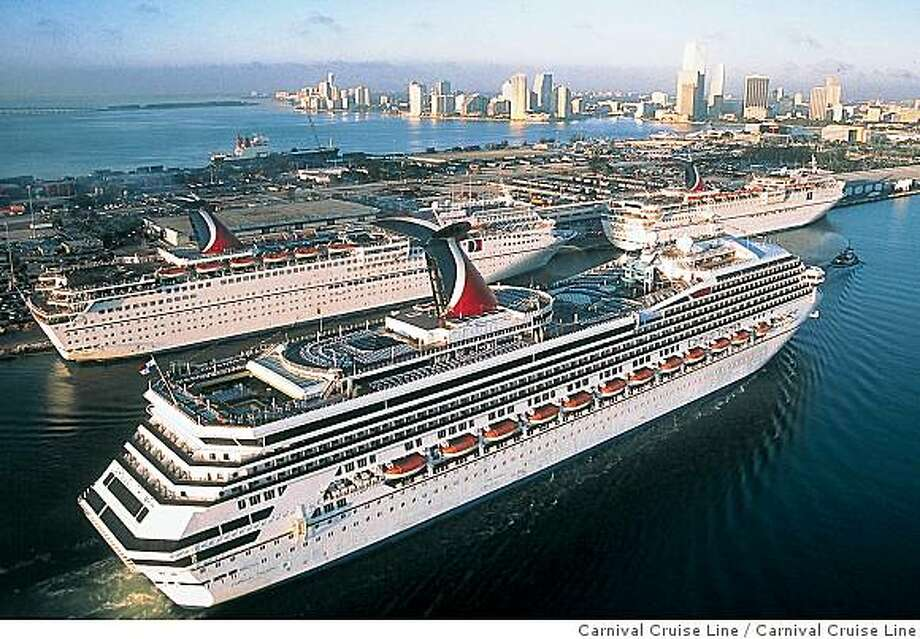 Carnival Cruise Line's ship Carnival Triumph sails past two other of the company's ships in Miami, Fla. The company announced it will eliminate a $9 per day fuel surcharge for cruises in 2010, but also plans to raise fares to reflect long-term higher costs. Photo: Carnival Cruise Line