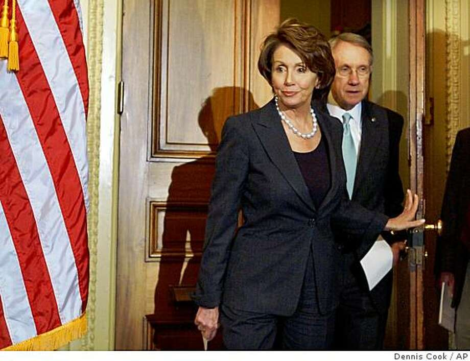 House Speaker Nancy Pelosi of Calif. left, followed by Senate Majority Leader Harry Reid of Nev., arrive for a news conference on Capitol Hill in Washington, Thursday, April 26, 2007, to urge President Bush to sign the war funding bill just passed by Congress. (AP Photo/Dennis Cook) Photo: Dennis Cook, AP