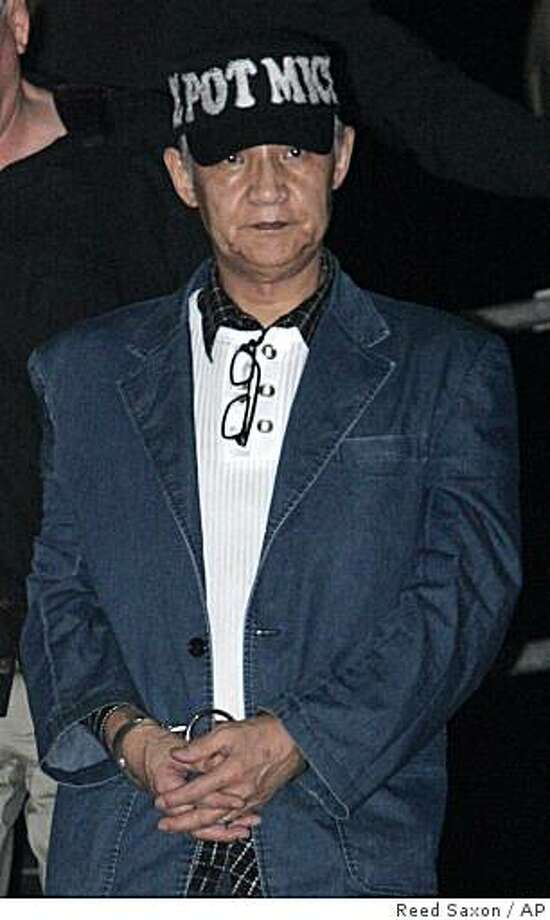 In this early Friday, Oct. 10, 2008 picture, Kazuyoshi Miura, 61, a Japanese businessman accused of arranging the murder of his wife in Los Angeles in the early 1980s, arrives at Los Angeles International Airport escorted by Los Angeles police after being extradited from Saipan. A Los Angeles judge on Tuesday, Oct. 14, 2008 formally dismissed the case against a Japanese businessman who hanged himself in a jail cell while awaiting trial for allegedly plotting his wife's death 27 years ago during a visit to Los Angeles. Photo: Reed Saxon, AP