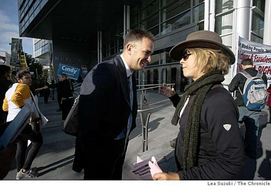 Convention attendee Rick Roque of Washington DC, Calif. talks with protester Melissa Hafez of Berkeley, Calif. outside the Mortgage Bankers Associatoin's annual convention at Moscone West on Monday October, 20 2008 in San Francisco, Calif. Photo: Lea Suzuki, The Chronicle
