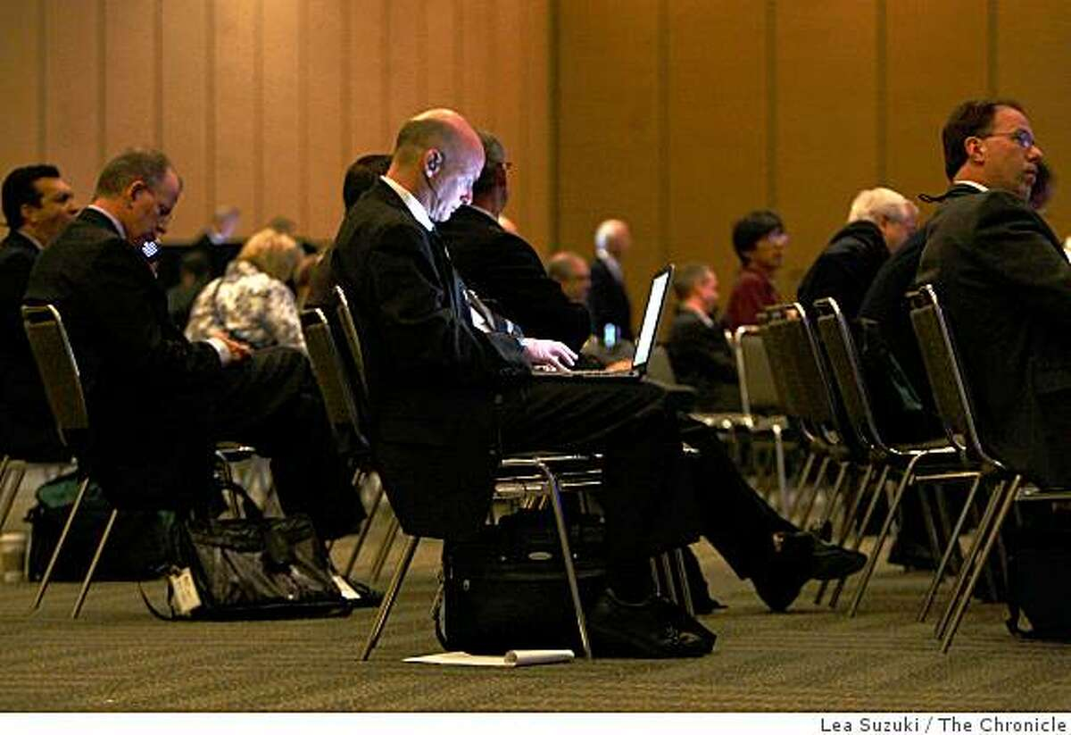 Mike Murray of Washington DC., with MBA Newslink, works on his computer during the morning General Session at the Mortgage Bankers Association's annual convention at Moscone West on Monday October, 20 2008 in San Francisco, Calif.