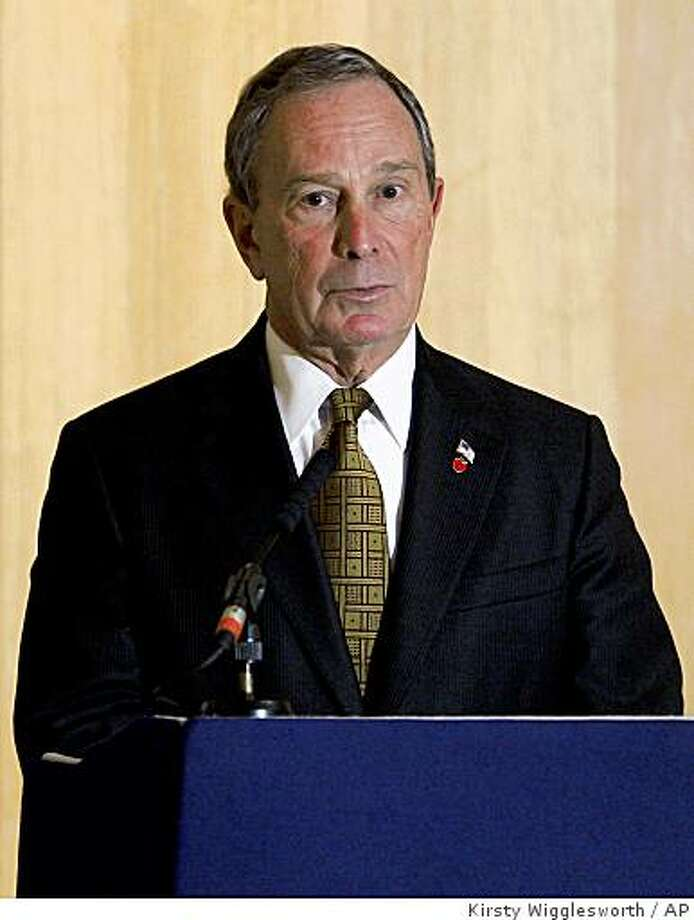 **FILE** This Oct. 6, 2008 file photo shows Mayor of New York Michael Bloomberg delivering a lecture in London. A group opposed to Bloomberg's bid to change the city's term-limits law so he can run again filed a complaint with a city government oversight board on Thursday, Oct. 9, 2008 alleging he abused his power by striking a deal to win over a potential foe. (AP Photo/Kirsty Wigglesworth) Photo: Kirsty Wigglesworth, AP