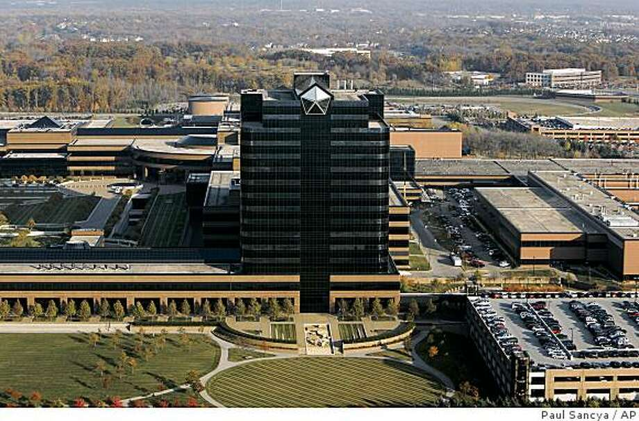 **FILE** Chrysler LLC headquarters are shown in Auburn Hills, Mich., Nov. 2, 2005. Cash-desperate GM is said to be interested in Chrysler first for its pile of money. The struggling Chrysler reportedly has about $11 billion available even though its sales have dropped 25 percent during the first nine months of the year. It also has debt, but those figures aren't available because it's a private company, 80.1 percent owned by Cerberus Capital Management LP.  (AP Photo/Paul Sancya, file) Photo: Paul Sancya, AP