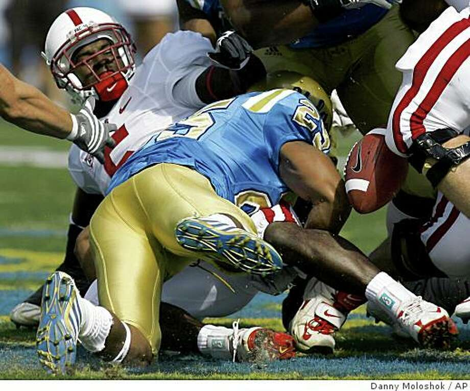 Stanford running back Anthony Kimble, left, fumbles the ball as he is tackled by UCLA defensive back Bret Lockett during the first quarter of an NCAA college football game on Saturday, Oct. 18, 2008 in Pasadena, Calif. (AP Photo/Danny Moloshok) Photo: Danny Moloshok, AP