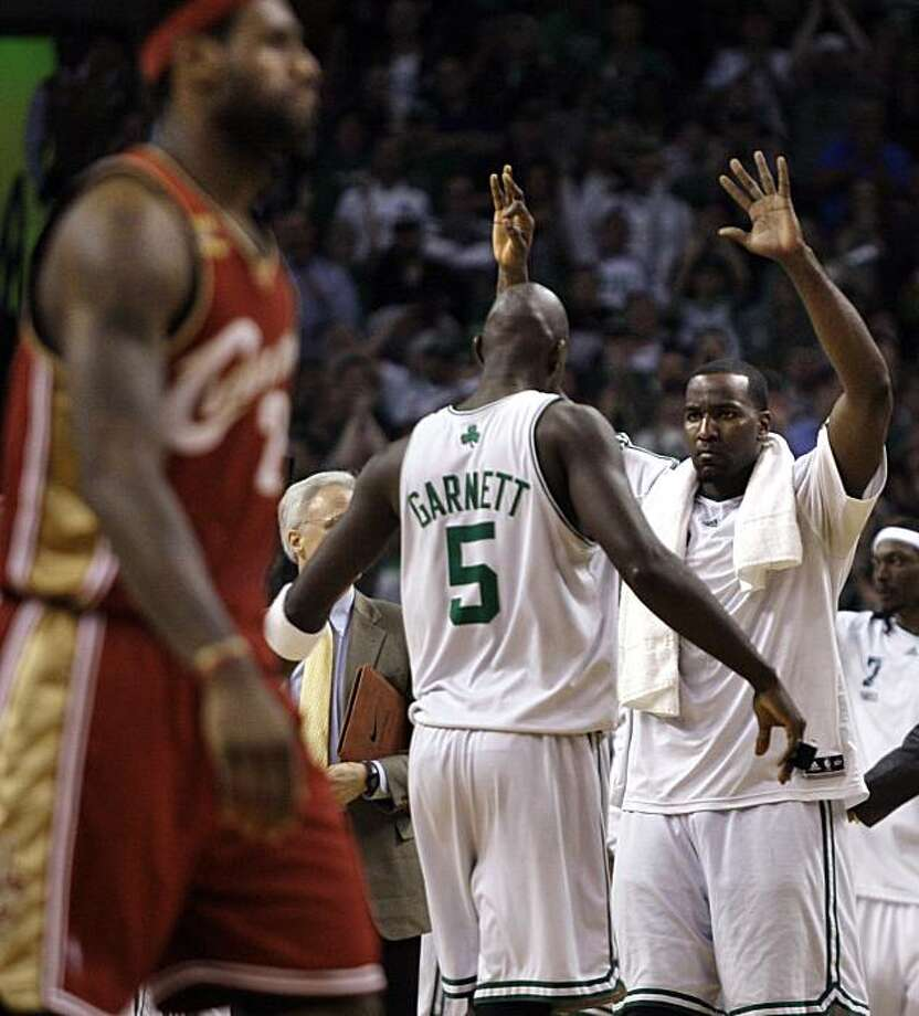 Boston Celtics forward Kevin Garnett (5) and teammate Kendrick Perkins, right, celebrate as Cleveland Cavaliers forward LeBron James, left, walks to the bench during a timeout late in the fourth quarter of Game 6 in a second-round NBA basketball playoff series in Boston on Thursday, May 13, 2010. The Celtics won 94-85, knocking the Cavaliers from the playoffs. Photo: Elise Amendola, AP