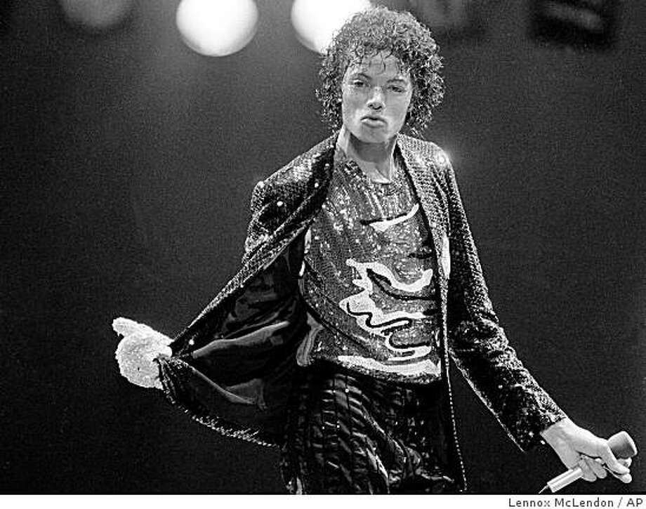 Pop artist Michael Jackson, center, is shown onstage at opening night of his Victory Tour at Dodger Stadium in Los Angeles in 1984. Photo: Lennox McLendon, AP