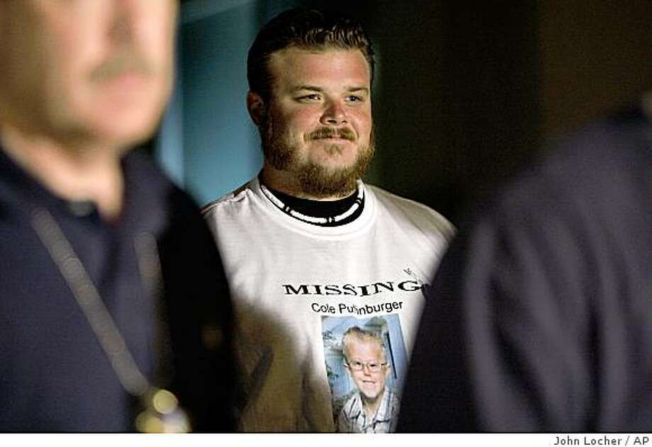 Robert Puffinburger waits to talk at a news conference in Las Vegas early Sunday, Oct. 19, 2008. Robert's son Cole Mason Puffinburger, who was kindapped on Oct. 15, was found alive Saturday in Las Vegas. (AP Photo/Las Vegas Review-Journal, John Locher) Photo: John Locher, AP