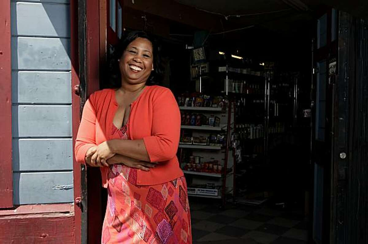 Film maker Carmen Madden stands outside the store where her movie Every Black Man takes place, Friday April 30, 2010, in Oakland, Calif. Every Black Man is Maddens first film and has won awards and will premier the movie at the Bal Theater in San Leandro on May 21.