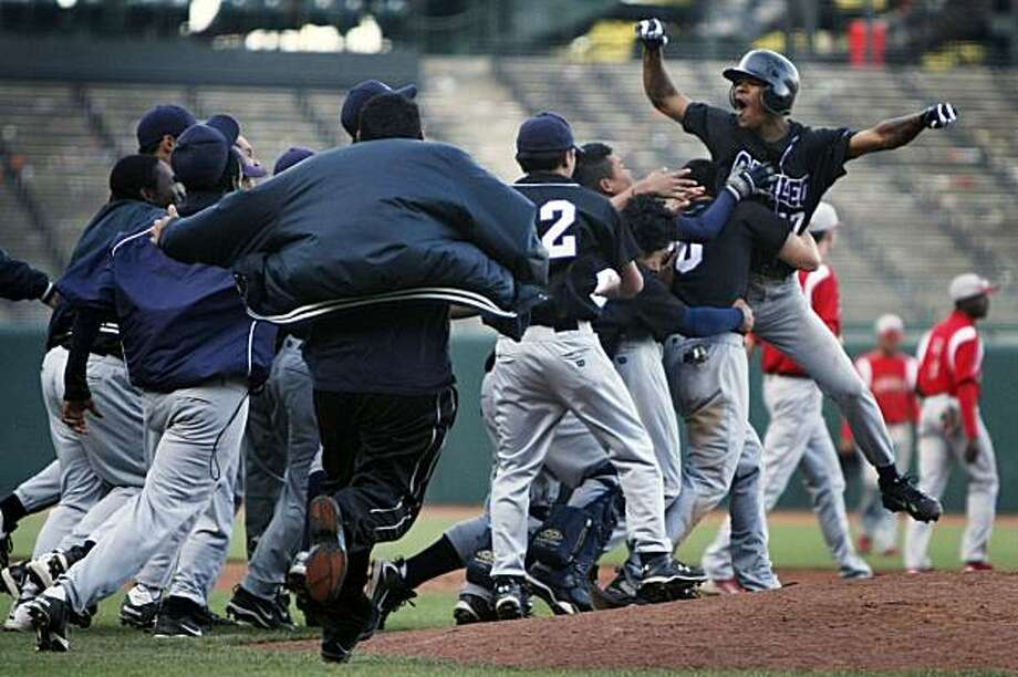 Galileo High School's Erik Wilson, right, is mobbed by his teammates after he hit the single that scored Jeffrey Hua in the bottom of the ninth inning to win the city championship at San Francisco's AT&T Park on Thursday. Photo: Lance Iversen, The Chronicle