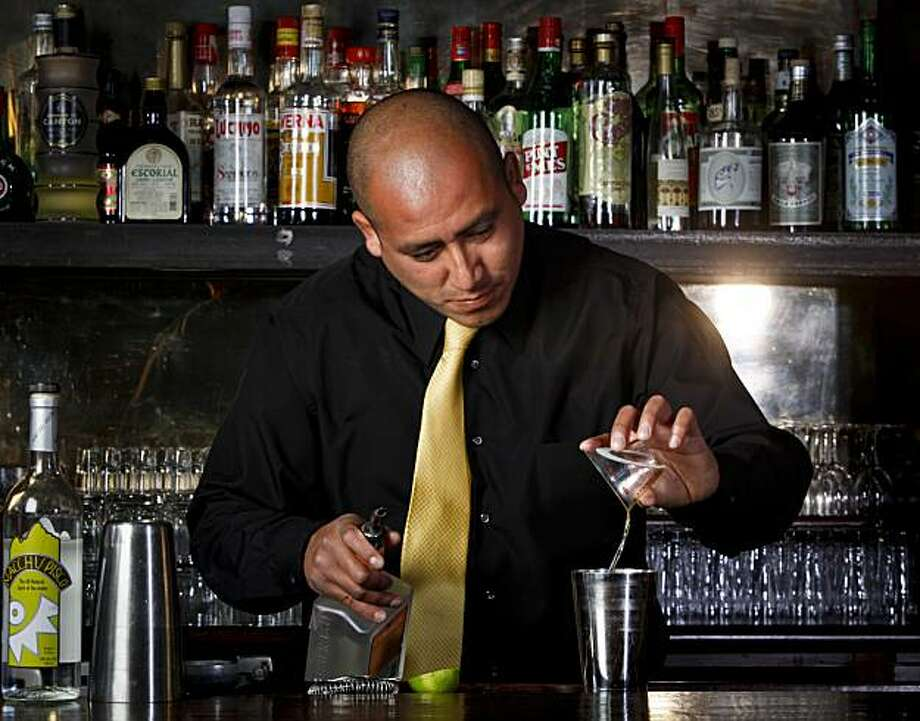 "Enrique Sanchez of La Mar mixes a ""Pasion Andina"" at 15 Romolo in San Francisco, Calif. on Tuesday May 11, 2010. Photo: Lea Suzuki, The Chronicle"