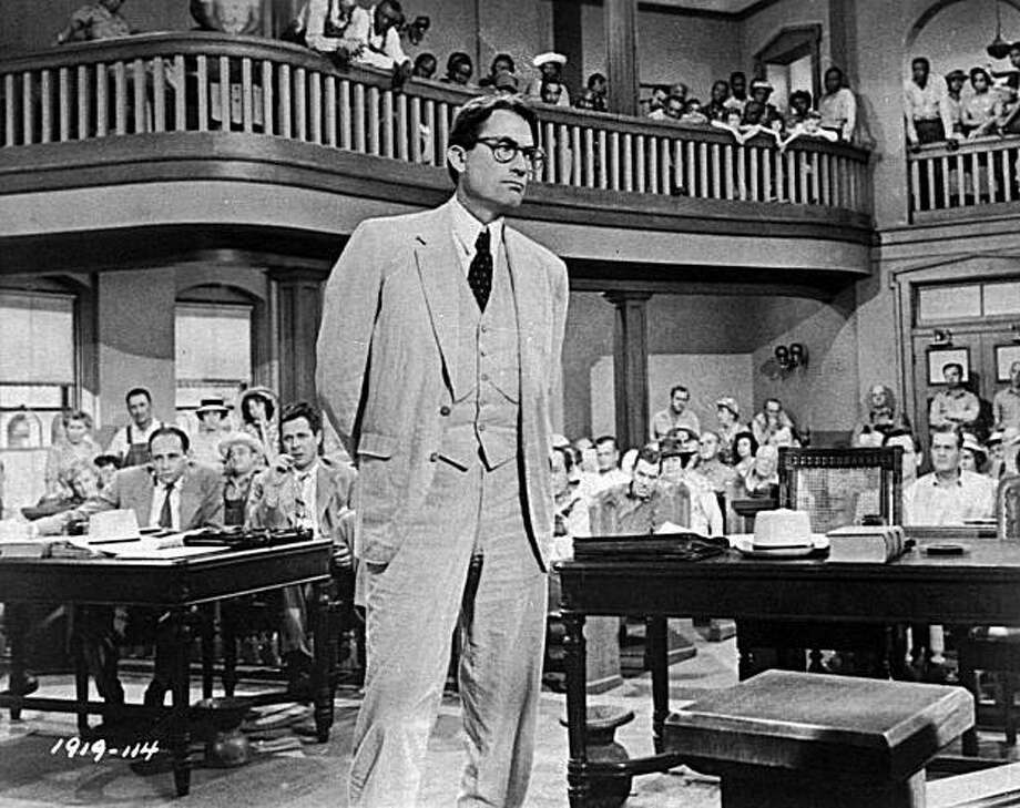 """FILE ** In this 1962 file photo, actor Gregory Peck is shown as attorney Atticus Finch, a small-town Southern lawyer who defends a black man accused of rape, in a scene from """"To Kill a Mockingbird."""" The classic film was ranked second on the American Film Institute's list of inspirational films revealed Wednesday, June 14, 2006, during its annual top-100 film television special. (AP Photo) Photo: AP"""
