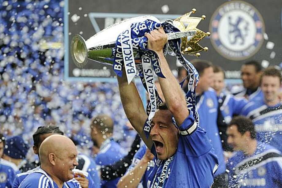 Chelsea's John Terry celebrates winning the English Premier League title with the trophy after defeating Wigan Athletic at the end of their English Premier League soccer match at Stamford Bridge, London, Sunday, May 9, 2010. Photo: Tom Hevezi, AP