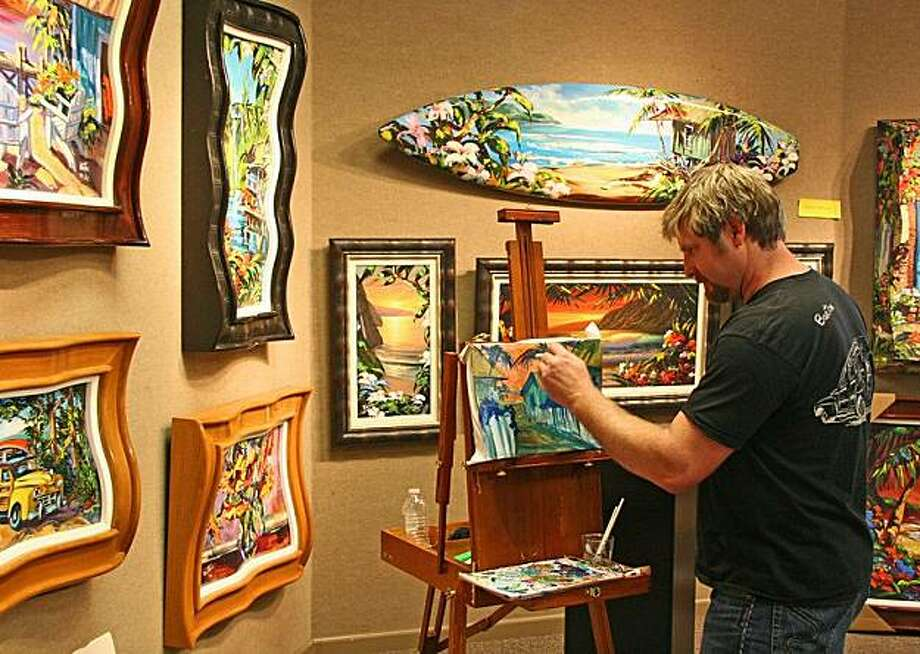 Steve Barton works on a beach scene at Marcus Ashley Gallery in South Lake Tahoe. Photo: Mark S. Bacon, Special To The Chronicle