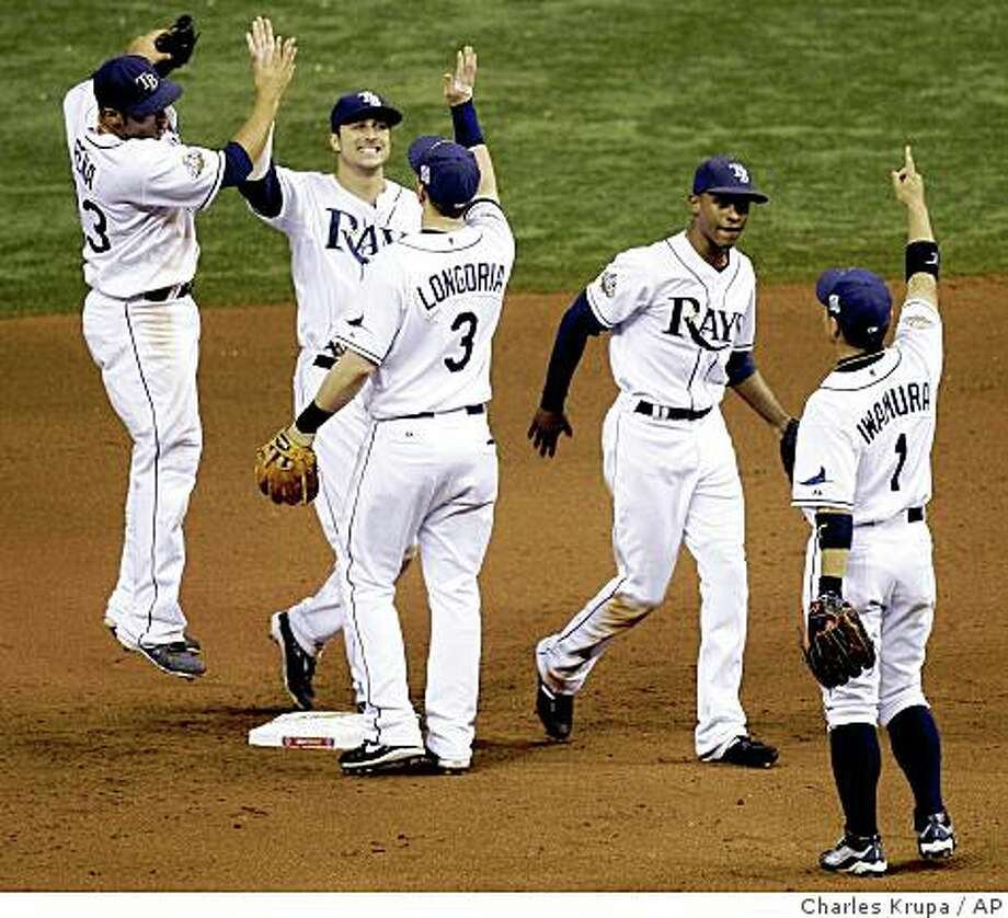 Tampa Bay Rays' Carlos Pena, left to right, Rocco Baldelli, Evan Longoria, B.J. Upton, Akinori Iwamura celebrate after Game 2 of the baseball World Series against the Philadelphia Phillies in St. Petersburg, Fla., Thursday, Oct. 23, 2008. The Rays won the game 4-2 to tie the series 1-1. Photo: Charles Krupa, AP