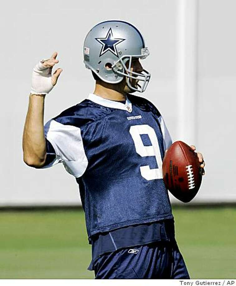 Tony Romo motions during practice at the Cowboys training facility in Irving, Texas, Friday, Oct. 17, 2008. Photo: Tony Gutierrez, AP