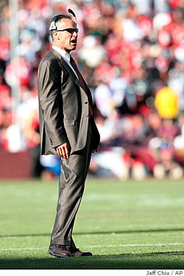 San Francisco 49ers' coach Mike Nolan watches from the sidelines as the 49ers played the Philadelphia Eagles in the fourth quarter of an NFL football game in San Francisco, Sunday, Oct. 12, 2008. The Eagles won 40-26. (AP Photo/Jeff Chiu) Photo: Jeff Chiu, AP