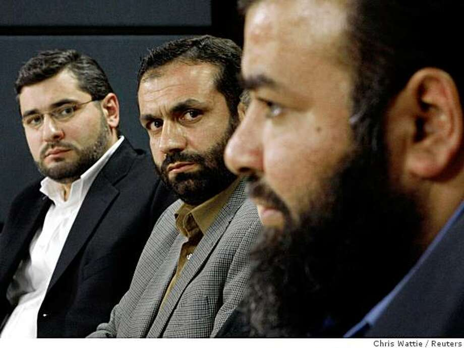 Abdullah Almalki (L) and Muayyed Nureddin (C) listen as Ahmad El Maati speaks during a news conference in Ottawa October 21, 2008. Canadian security services probably contributed indirectly to the torture in Syria of the three Arab Canadians who had been suspected of involvement in terrorist activities, an official inquiry found on Tuesday.       REUTERS/Chris Wattie       (CANADA) Photo: Chris Wattie, Reuters