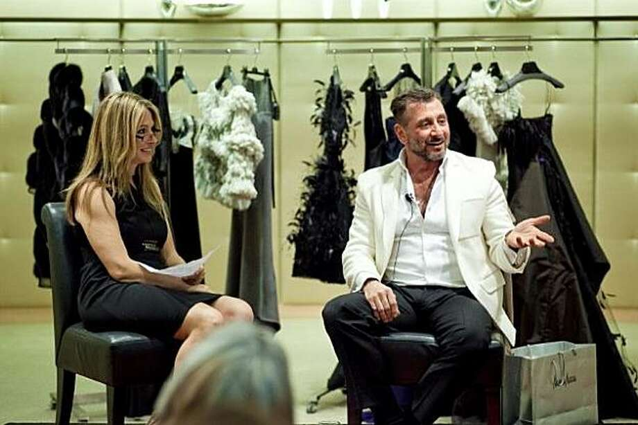 SF Chronicle Style reporter Carolyne Zinko interviews fashion designer Ralph Rucci about his collection before a small group of customers gathered for a trunk show featuring his work at Neiman Marcus on April 29, 2010. Photo: Drew Altizer