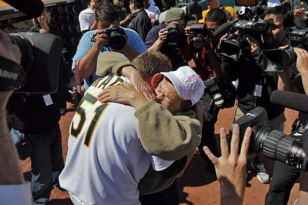 Dallas Braden celebrates with his grandmother, Peggy Lindsey of Stockton, after pitching a perfect game on Mother's Day. Braden's mother has passed away and his grandmother attended the game. Photo: Carlos Avila Gonzalez, The Chronicle