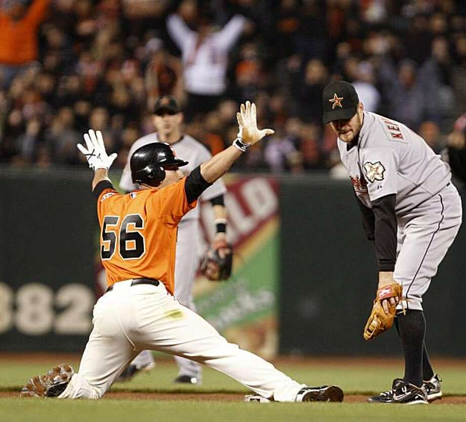 San Francisco Giants' Andres Torres (56) beats the tag of Houston Astros second baseman Jeff Keppinger, right, for a double during the fifth inning of a baseball game Friday, May 14, 2010, in San Francisco. Photo: Ben Margot, AP