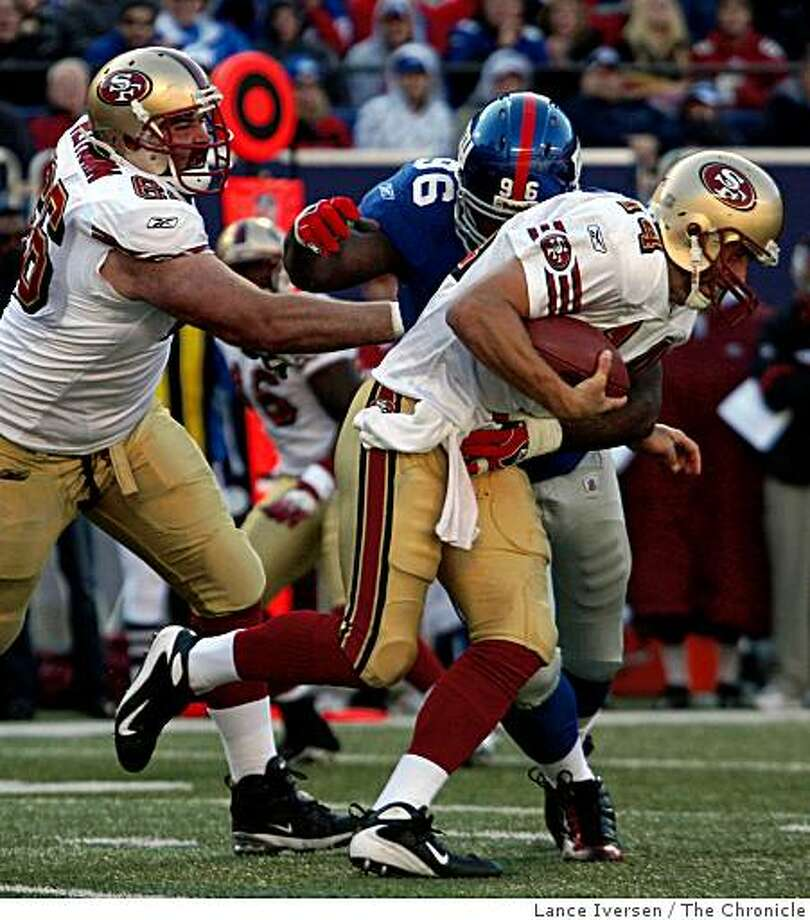 49ers quarterback J.T. O'Sullivan right is sacked by Giants Barry Cofield late into the second half Sunday October 19, 2008 in New York NY. The New York Giants defeated the San Francisco Giants 29-17 Photo: Lance Iversen, The Chronicle