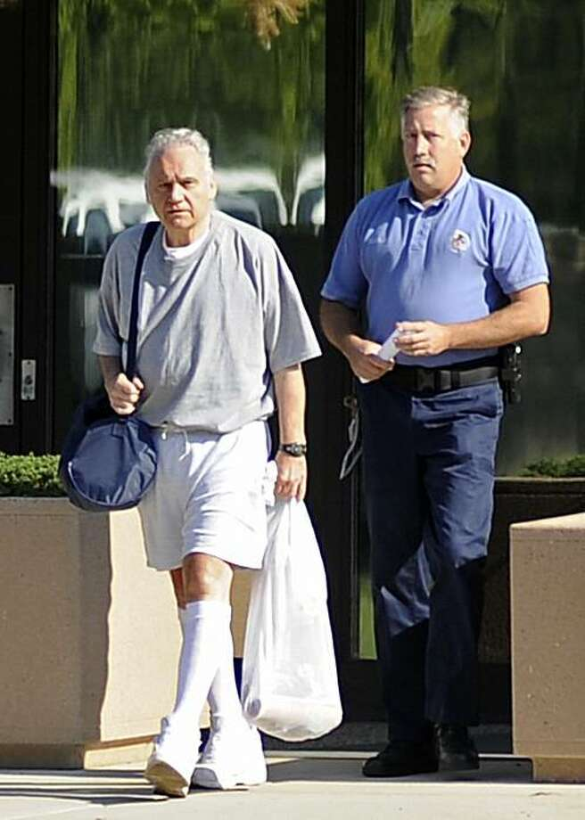 ** ADVANCE FOR SUNDAY, MAY 2 ** In this Sept. 2, 2009 file photo, former Ohio Democratic Rep. Jim Traficant, left, leaves a federal prison, while being escorted by an unidentified prison employee, this morning after serving seven years for bribery, racketeering and fraud in Rochester, Minn. People in northeast Ohio are watching to see if the former congressman will try to stage an unprecedented political comeback. Photo: Craig Lassig, AP