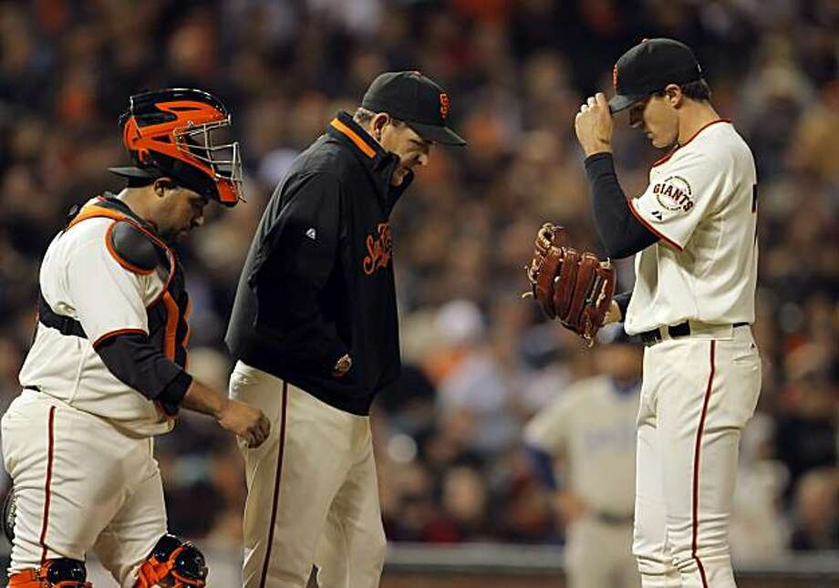 Pitching coach Dave Righetti and catcher, Bengie Molina come out to talk to starting pitcher, Barry Zito in the top of the fifth inning. Zito lasted only  5 innings. The San Francisco Giants played the San Diego Padres at AT&T Park in San Francisco, Calif., on Tuesday, May 11, 2010. Photo: Carlos Avila Gonzalez, The Chronicle