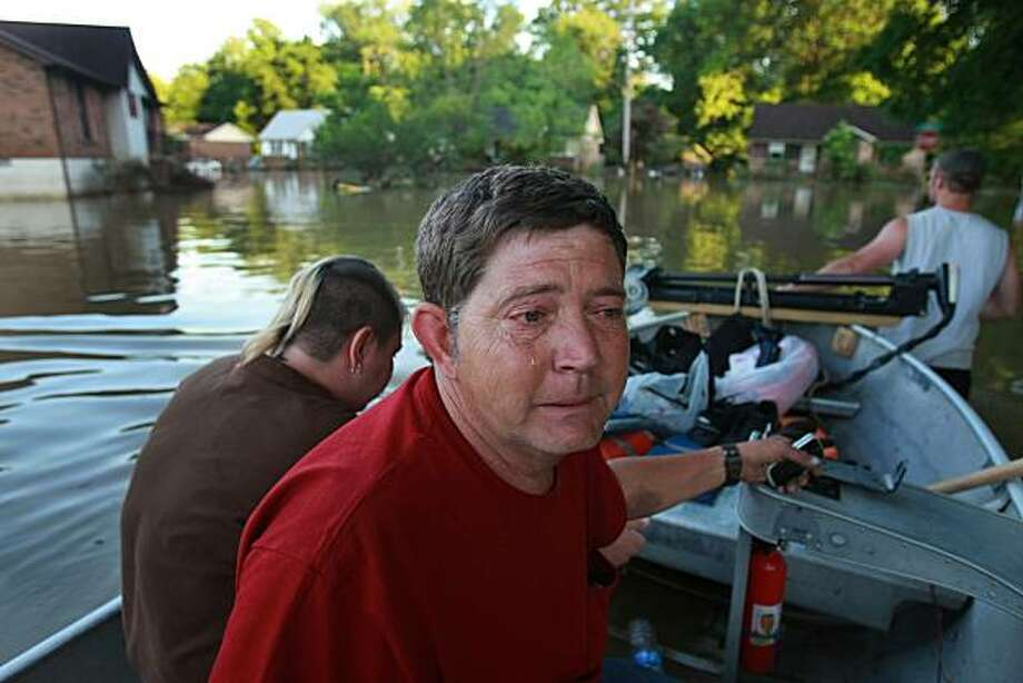 James Bryant, a resident of East Nashville, cries in a boat on the way back from his home in Nashville after he saw that everything in his home had been destroyed by flood waters, Thursday, May 6, 2010. Photo: John Partipilo, AP