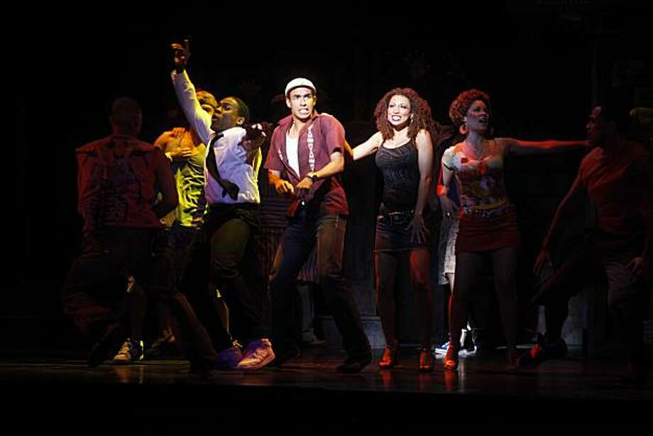 """Kyle Beltran (center) performs as the character Usnavi during the first act of """"In the Heights"""" at the Curran Theatre on Wednesday May 12, 2010 in San Francisco, Calif. Photo: Mike Kepka, The Chronicle"""