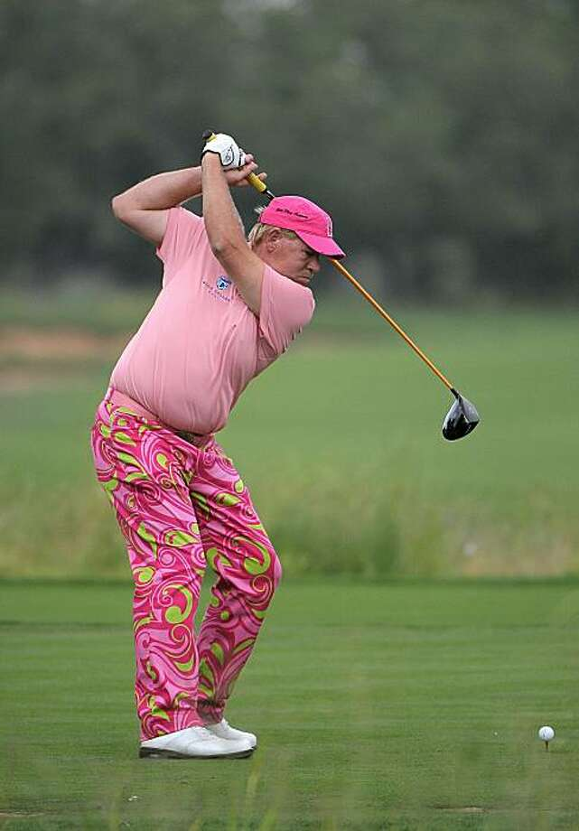 SAN ANTONIO, TX- MAY 13:  John Daly tees off on the 4th hole during the first round of the Valero Texas Open at the TPC San Antonio on May 13, 2010 in San Antonio, Texas. Photo: Marc Feldman, Getty Images