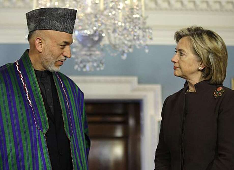 Afghanistan President Hamid Karzai, left, and Secretary of State Hillary Rodham Clinton look at each other as they address the media at the State Department in Washington, Tuesday, May 11, 2010. Photo: Carolyn Kaster, AP
