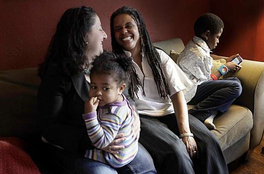 Ximena Delgado, left, sits with her partner Frederique Clermont and their two children Amelie, 20 months and Alejandro, 6 years old at their home, Thursday May 6, 2010, in San Francisco, Calif. Photo: Lacy Atkins, The Chronicle