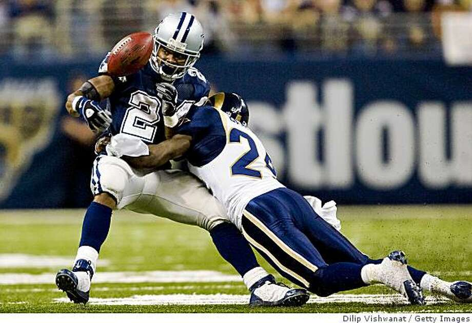 ST. LOUIS, MO - OCTOBER 19: Marion Barber #24 of the Dallas Cowboys has the ball knocked loose by Ron Bartell #24 of the St. Louis Rams at the Edward Jones Dome on October 19, 2008 in St. Louis, Missouri.  The Rams beat the Cowboys 34-14.  (Photo by Dilip Vishwanat/Getty Images) Photo: Dilip Vishwanat, Getty Images