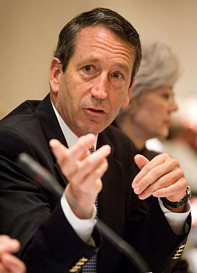 FILE - In this Feb. 21, 2010 photo, South Carolina Gov. Mark Sanford participates in the Southern Governors' Association meeting on energy independence during the National Governors Association winter meeting in Washington. Sanford says he spent this pastweekend with his Argentine lover in Florida. He told reporters at a news conference on an unrelated issue Wednesday May 12, 2010 that he spent several days with Maria Belen Chapur to see if they could restart their relationship. Photo: Cliff Owen, AP