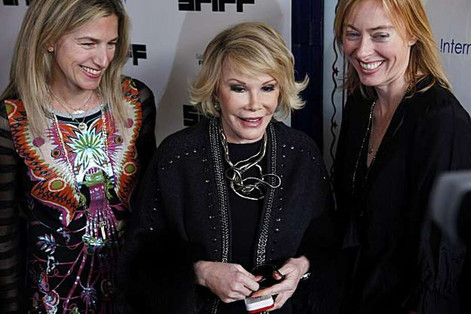 "Joan Rivers poses for photos with Ricki Stern, left, and Annie Sundberg, right, who directed the documentary, ""Joan Rivers: A Piece of Work,"" at the Castro Theater in San Francisco, Calif., on Thursday, May 6, 2010, for the closing night of the San Francisco Film Festival. Photo: Carlos Avila Gonzalez, The Chronicle"