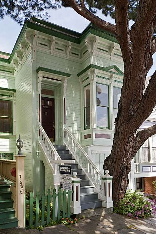Built in 1900, 3088 Market Street in the Castro features two bedrooms, two bathrooms, numerous period details, a sun porch and a rear garden. The 1,050 square foot house is listed for $849,000. Photo: OpenHomesPhotography.com