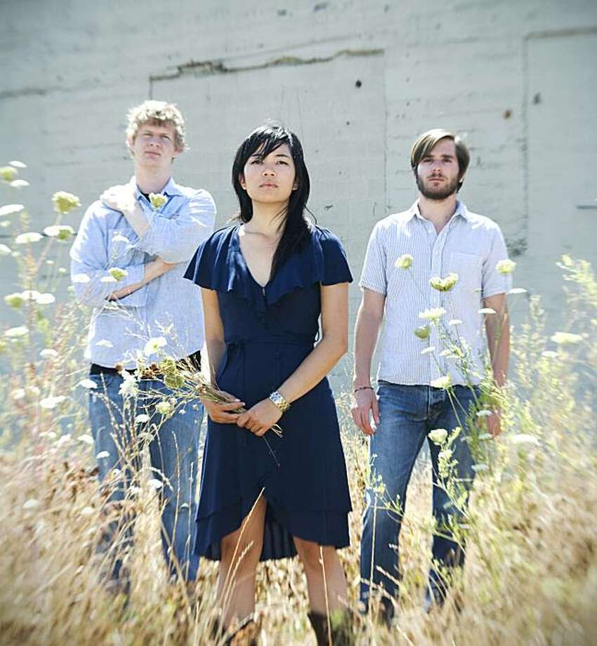 Thao with The Get Down Stay Down: Willis (from left), Thao and Adam. Photo: Tarina Westlund
