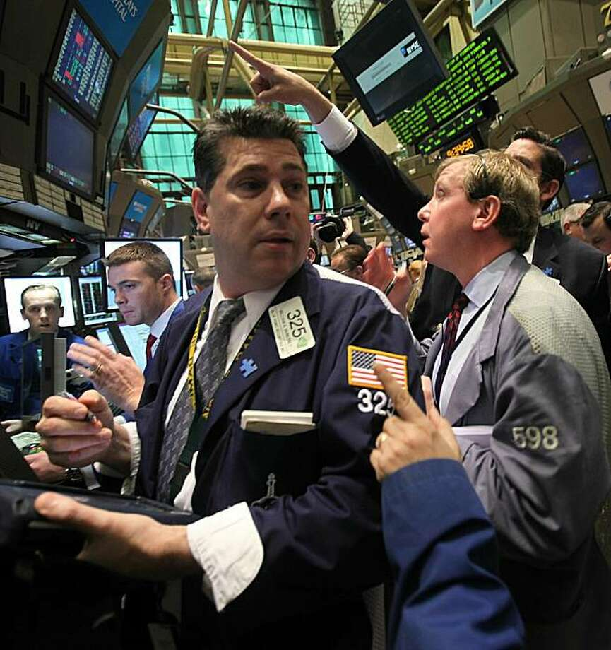 Traders work on the floor of the New York Stock Exchange after the opening bell May 7, 2010 in New York City. Stocks began the session mixed after a wild ride Thursday with the Dow plunging almost 1000 points before closing down 347 points. Photo: Mario Tama, Getty Images
