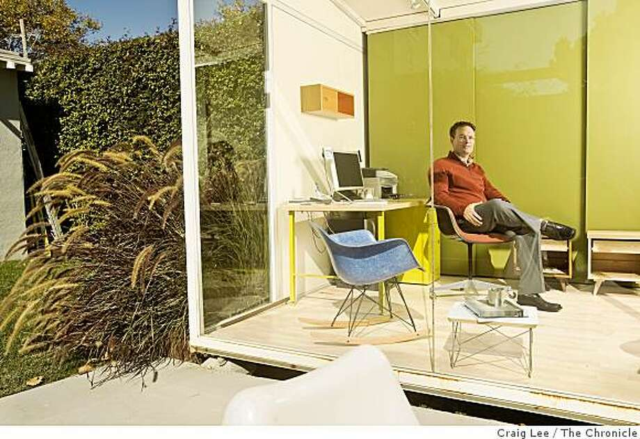 "Edgar Blazona, owner of a small furniture business called ""elevate HOME,"" at his office in the backyard of his home, in Bekeley, Calif., on October 15, 2008. His business has fallen off first by the high fuel costs, followed by the financial crisis. Photo: Craig Lee, The Chronicle"