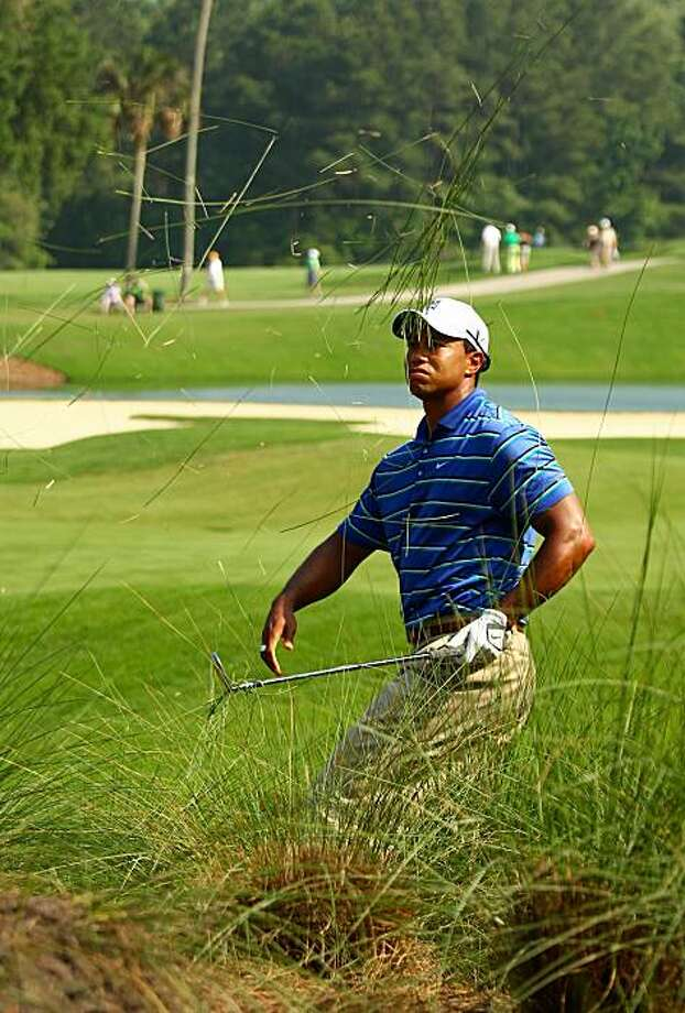 PONTE VEDRA BEACH, FL - MAY 06:  Tiger Woods watches his shot from the rough on the 12th hole during the first round of THE PLAYERS Championship held at THE PLAYERS Stadium course at TPC Sawgrass on May 6, 2010 in Ponte Vedra Beach, Florida. Photo: Richard Heathcote, Getty Images