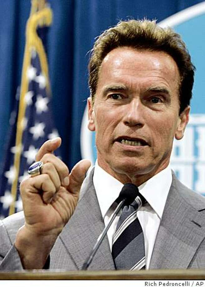 Gov. Arnold Schwarzenegger announced that he would veto a state budget plan that was approved by the Legislature, during a news conference at the Capitol in Sacramento, Calif., Tuesday, Sept. 16, 2008. Schwarzenegger said that the budget passed hours earlier failed to meet his reform demands and solve California's persistent fiscal problems.  (AP Photo/Rich Pedroncelli) Photo: Rich Pedroncelli, AP