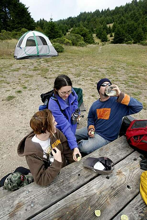 Robin McNeilley, left, Hollie Schell, center, and Rod Lacey, right,  salute Rod's birthday at Sky Camp, a hike-in campsite in Pt. Reyes, Calif. on Sunday, May 4, 2008. Photo by Katy Raddatz / San Francisco Chronicle Photo: Katy Raddatz, The Chronicle